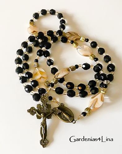 Handsome black and oval swirl lampwork Catholic rosary with bronze crucifix and center