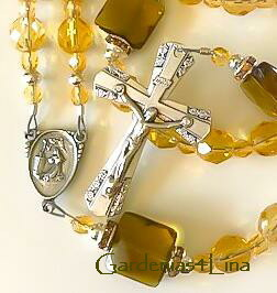 Detail of crucifix and center in Pale yellow Czech glass and sea glass limited edition rosary representing Saint Rita of Cascia