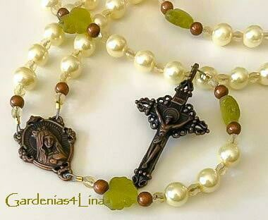 Glass pearl and copper rosary symbolizing the Blessed Virgin's title, Heaven's Masterpiece