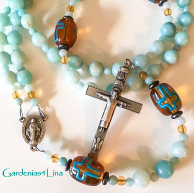 Limited edition handmade rosary created with blue amazonite, unique handmade lampwork and pewter fixtures celebrating the hope given by the Resurrection Of Jesus